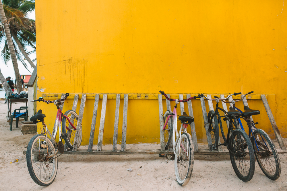 Bikes Against Yellow Wall in San Pedro Belize